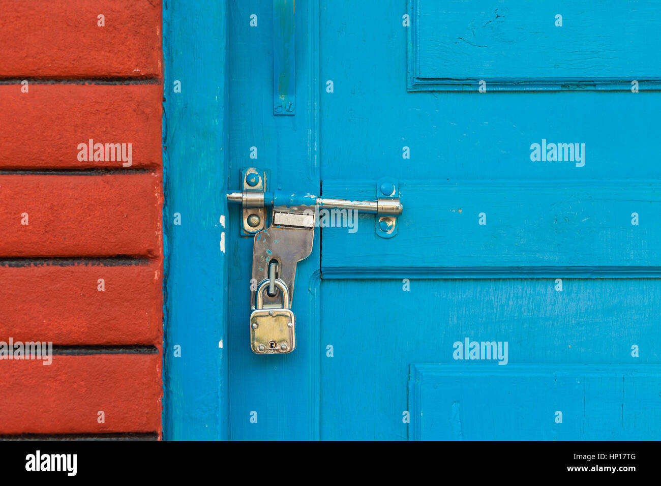 Padlocked door with bolt on the Indian subcontinent
