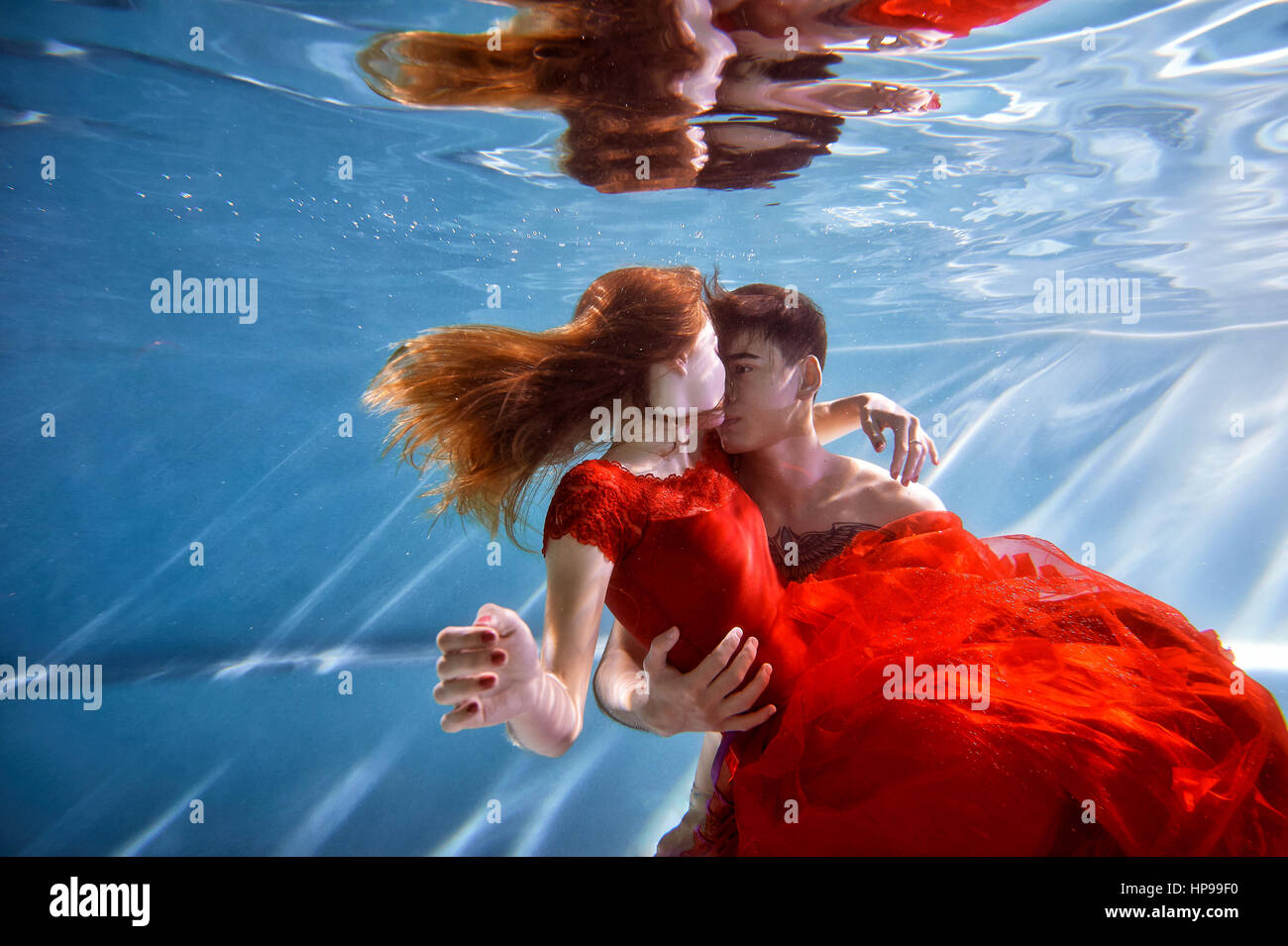 Stock Photo   Underwater In The Pool With The Purest Water. Loving Couple  Hugging. The Feeling Of Love And Closeness. Soft Focus