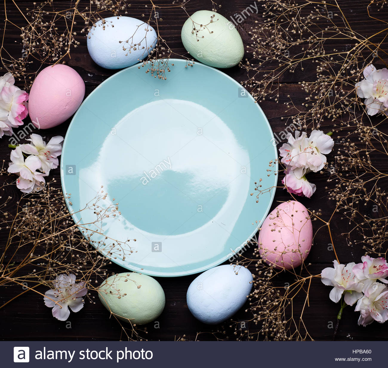 Pastel Color Easter Eggs With A Plate On Dark Wooden Bacgroung , Copy Space  Flat Lay