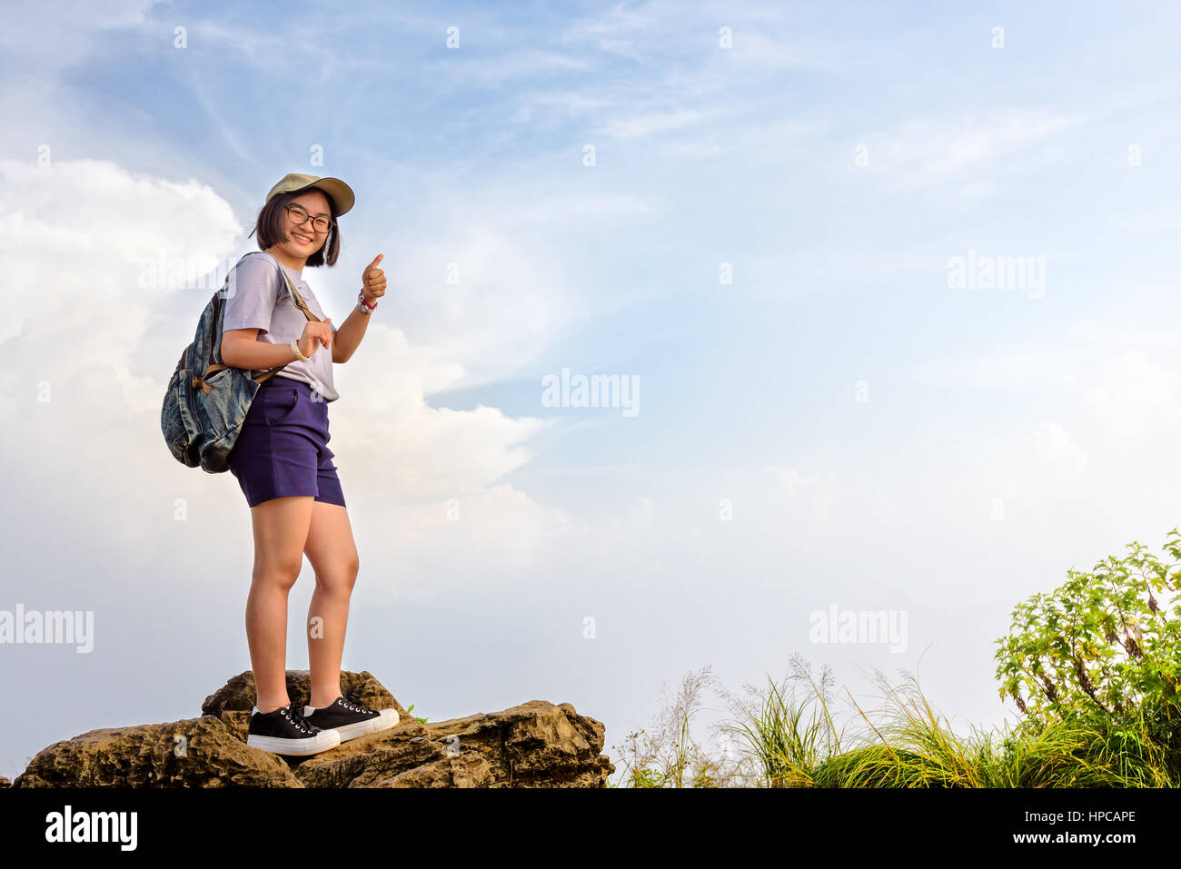 Cute Teens happy hiker asian cute teens girl with backpack cap and glasses