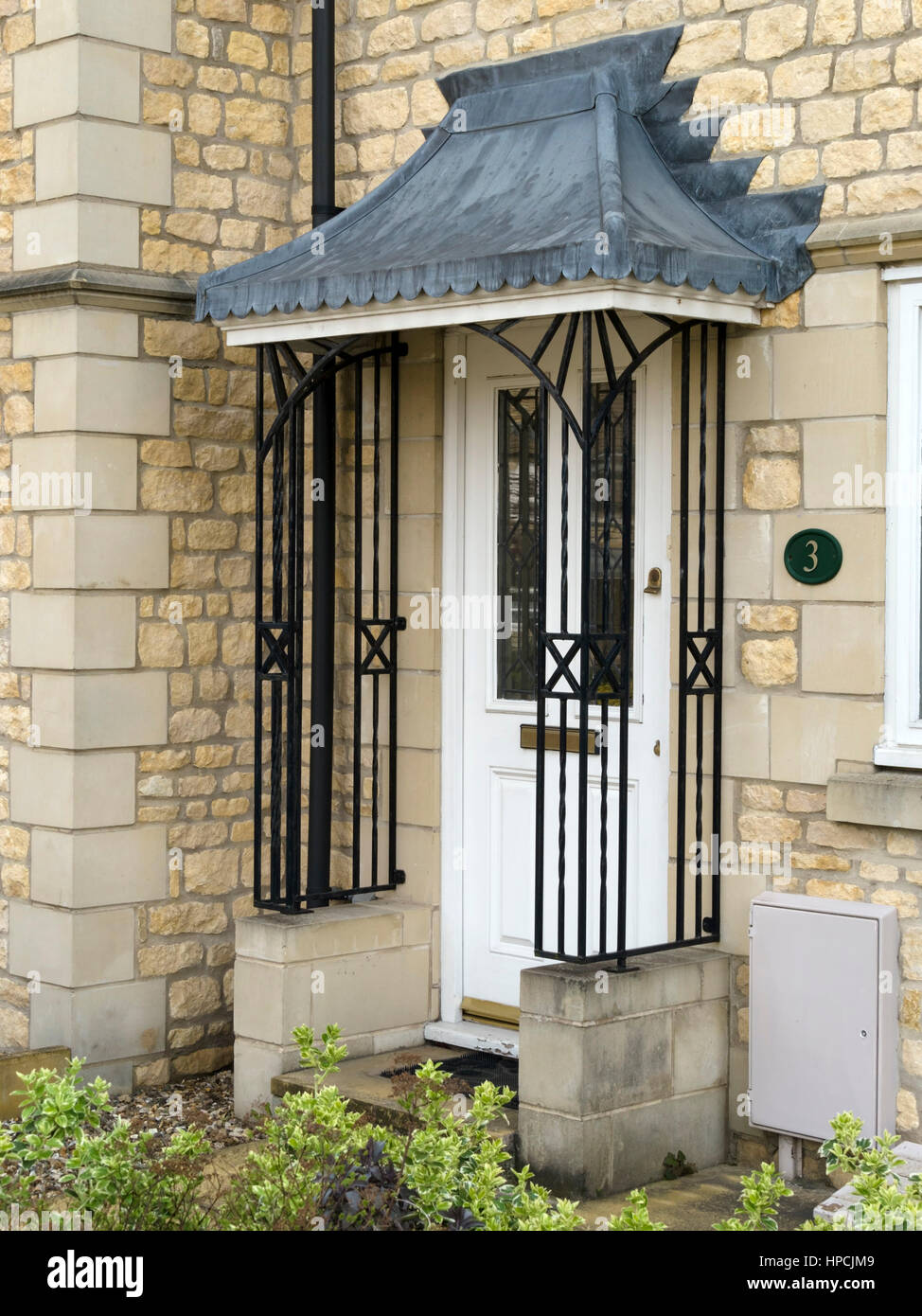 House Front Door With Ornate Wrought Iron Porch Railings And Lead Flashed  Roof Canopy, UK