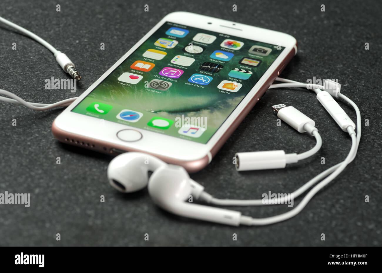 koszalin, poland – february 22, 2017: pink iphone 7 on stone table