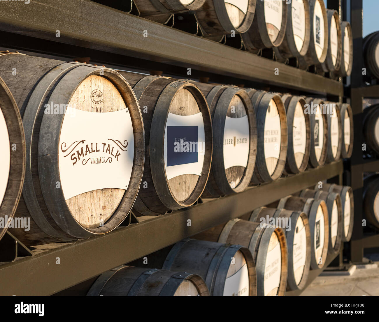 stacked oak wine barrels. Oak Wine Barrels Stacked On Racks With Names Of Wineries Located In The Niagara Region Ontario Canada I