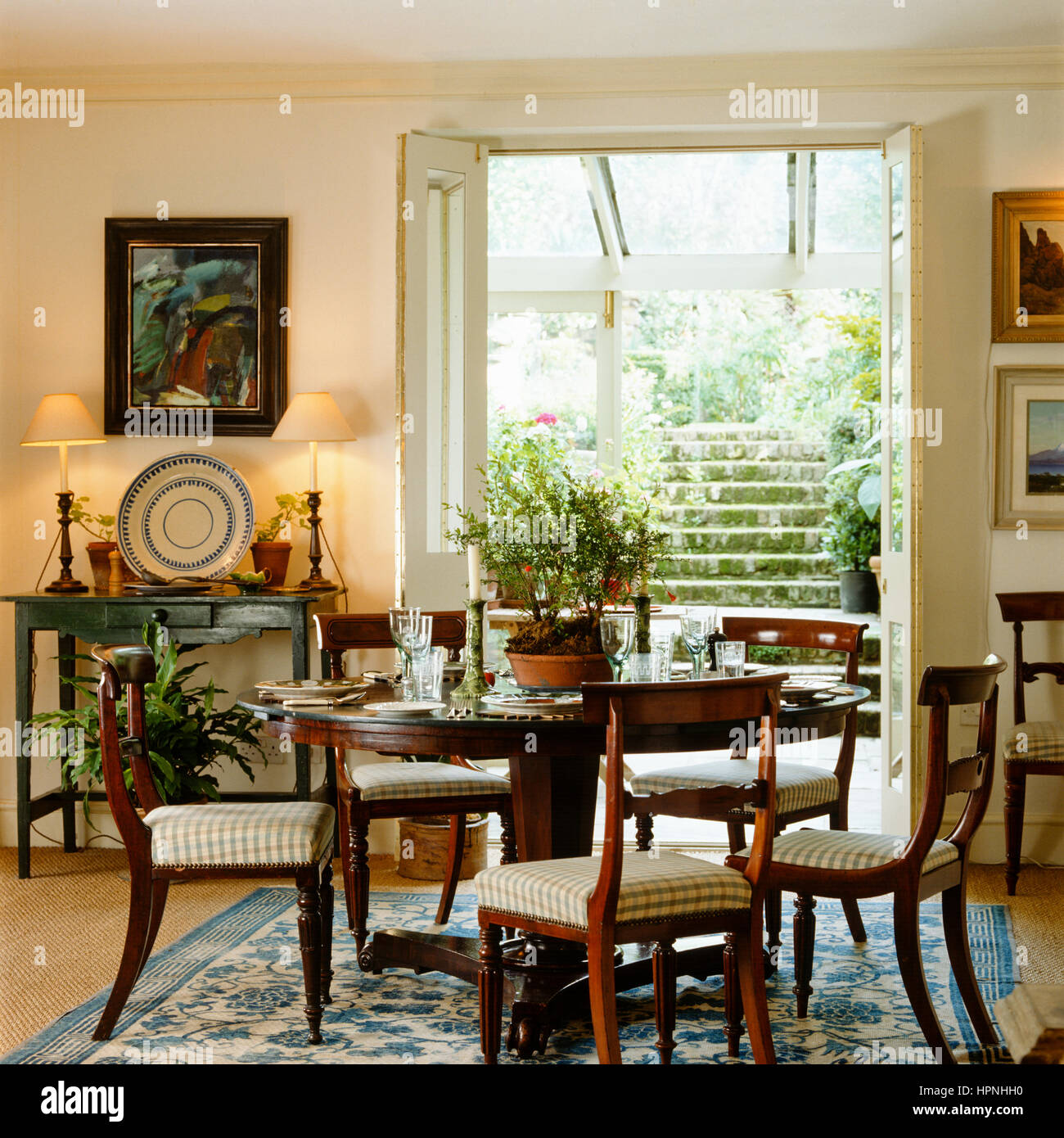 A country style dining room with french doors leading for Country style dining room