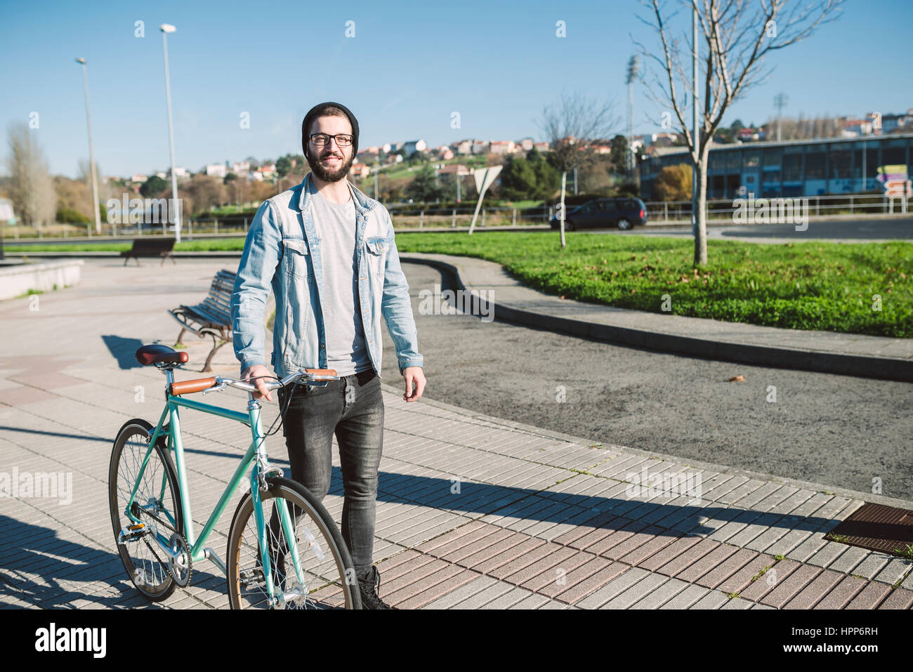 Young Man Walking With His Fixie Bike In A Park Stock Photo