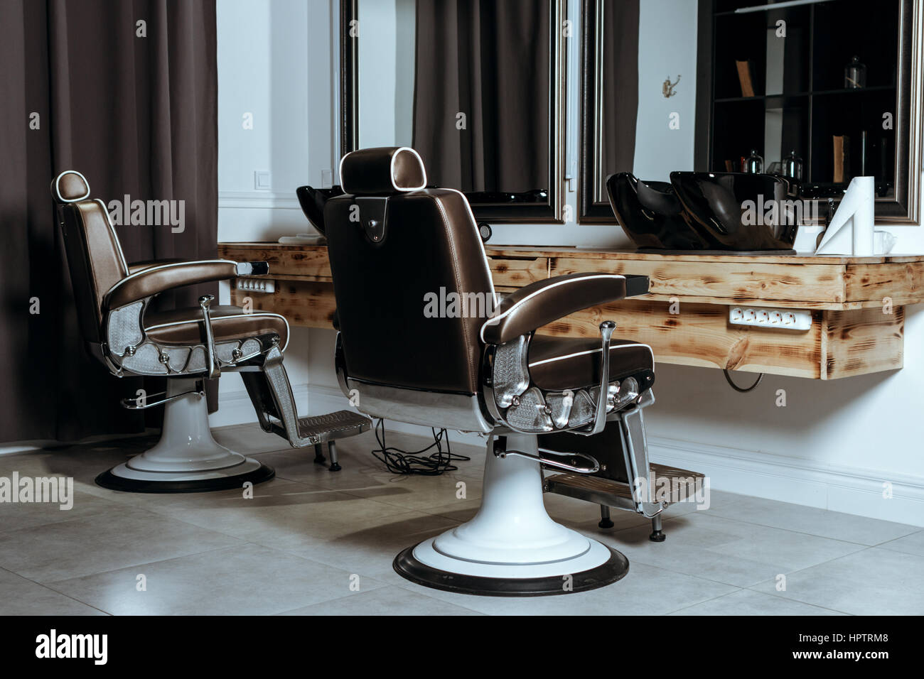 Vintage barber shop chairs - Stock Photo Stylish Vintage Barber Chairs In Wooden Interior Barbershop Theme