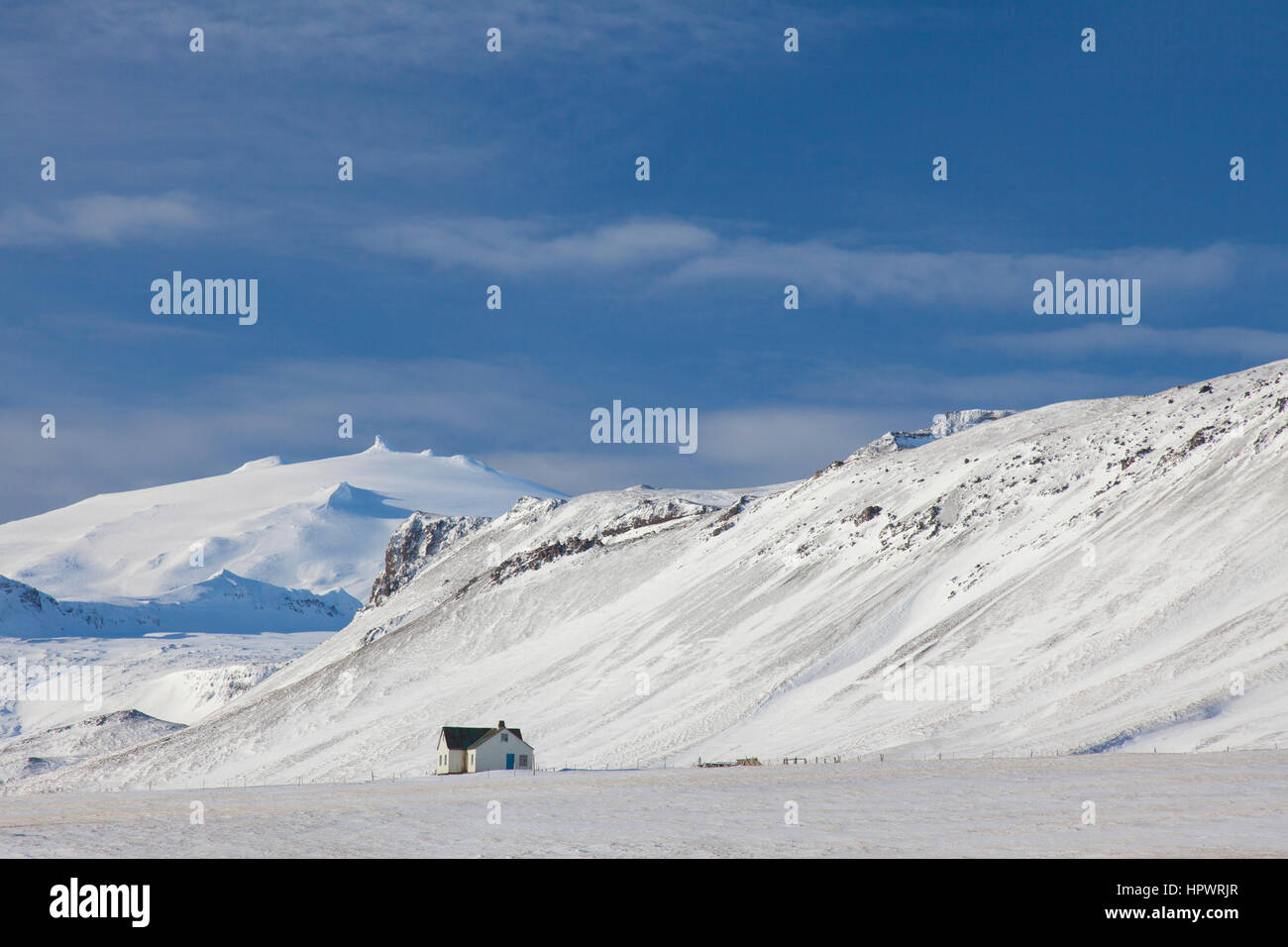 Lonely house in desolate landscape in the snow in winter for Iceland lonely house