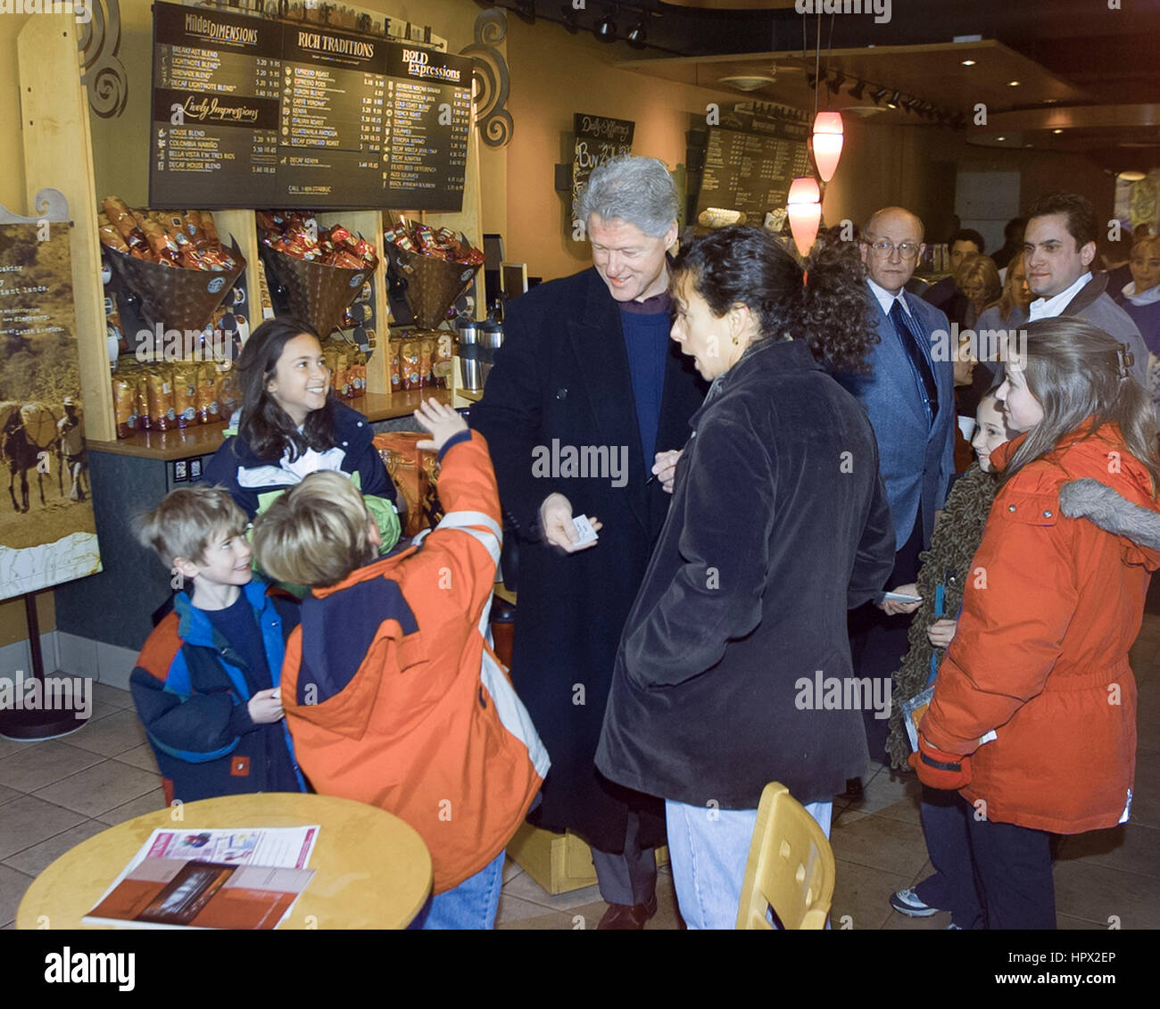 president bill clinton with customers at a starbucks coffee shop