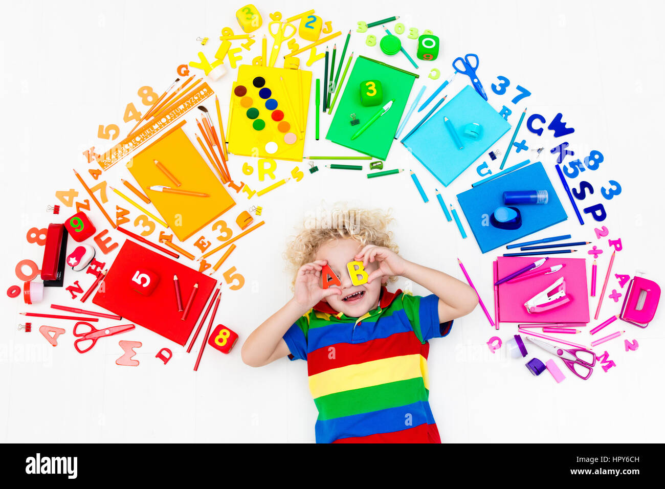 little boy with supplies books drawing and painting tools
