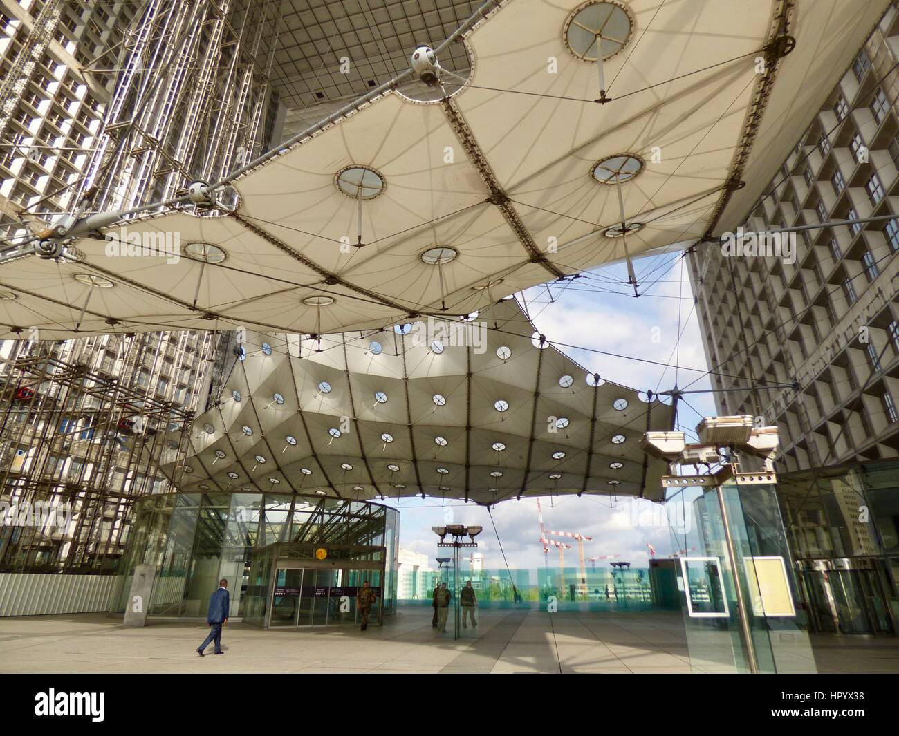 Underneath the canopy close-up. Business district. Grande Arche (Great Arch) at La Défense in the Paris France & Underneath the canopy close-up. Business district. Grande Arche ...