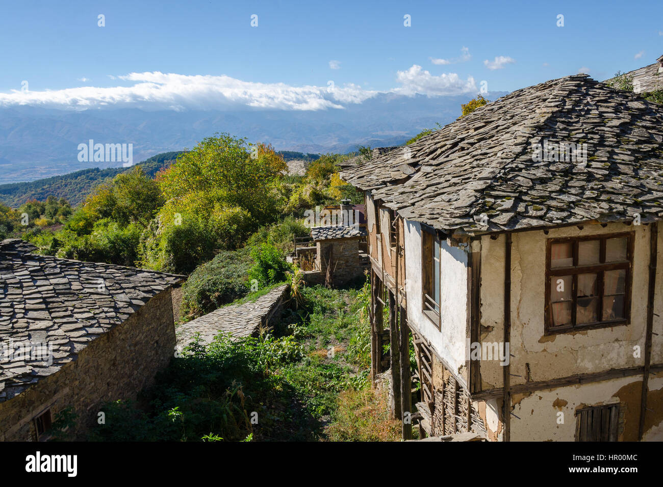 Old Traditional Houses With Slate Roofing Tiles In Leshten, Bulgaria
