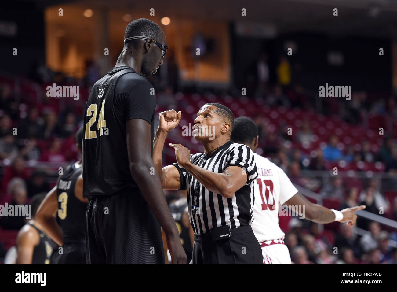 Official TED VALENTINE Looks Small As He Explains A Call To UCF Knights  Center TACKO FALL (24) During The American Athletic