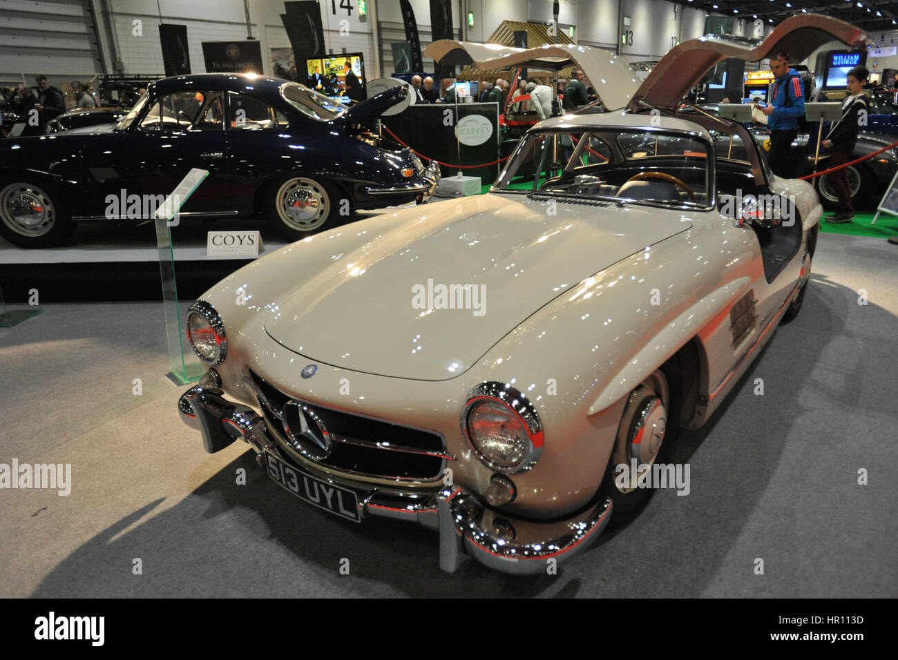 a 1955 mercedes benz 300sl gullwing on display at the london classic car show which