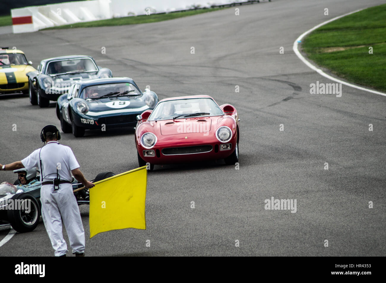Race cars on track at Goodwood Revival, coming into pit lane after ...