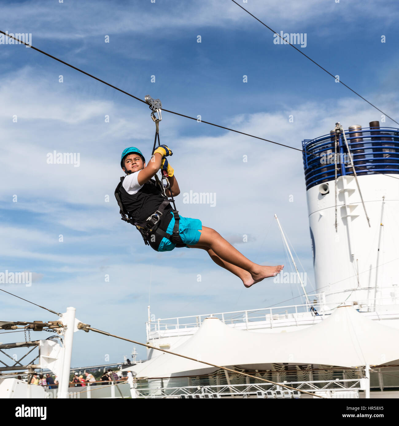 A Passenger On Cruise Ship Enjoys A Flying Fox Experience Stock - Flying cruise ship