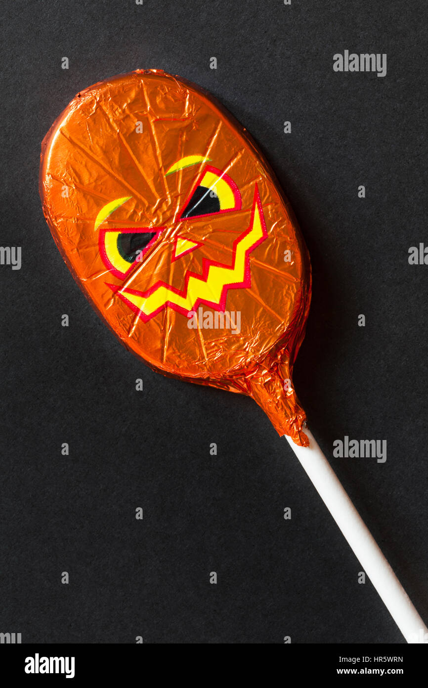 Halloween chocolate lolly foil wrapped with scary pumpkin face ...