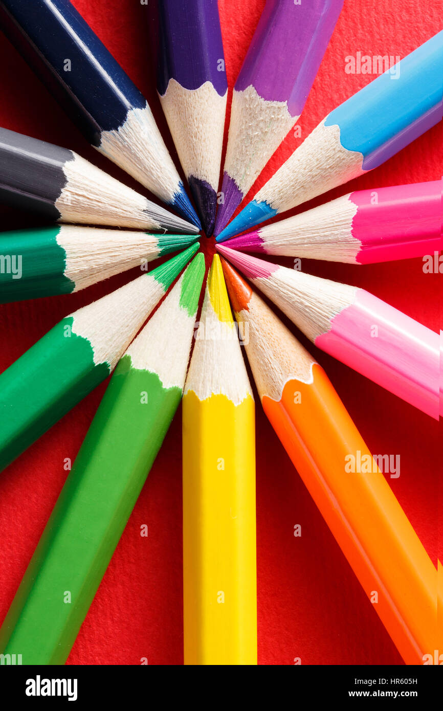 Circle color chart made of color pencils on the red background circle color chart made of color pencils on the red background nvjuhfo Images