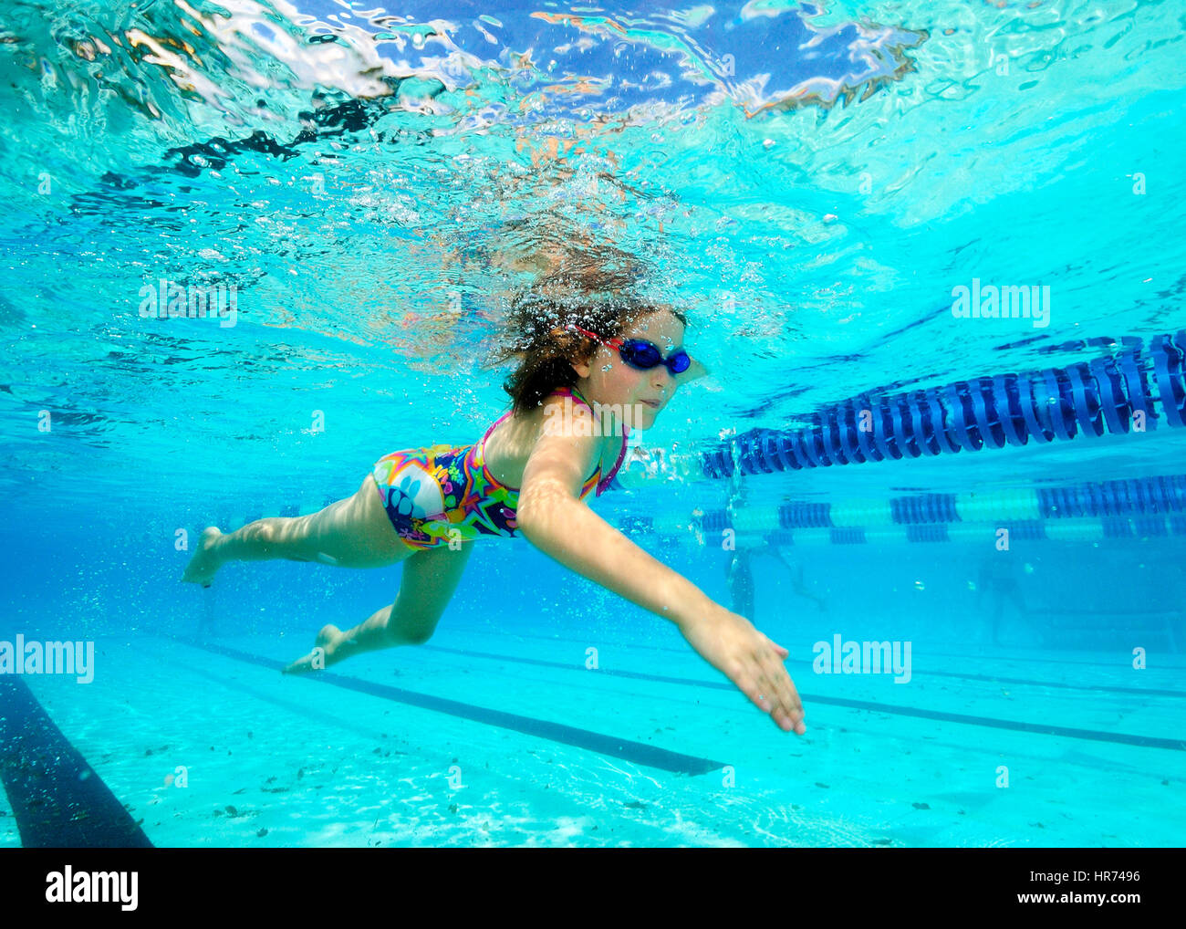 kids swimming underwater in pool enjoying the relaxation of summer - Kids Swimming Underwater