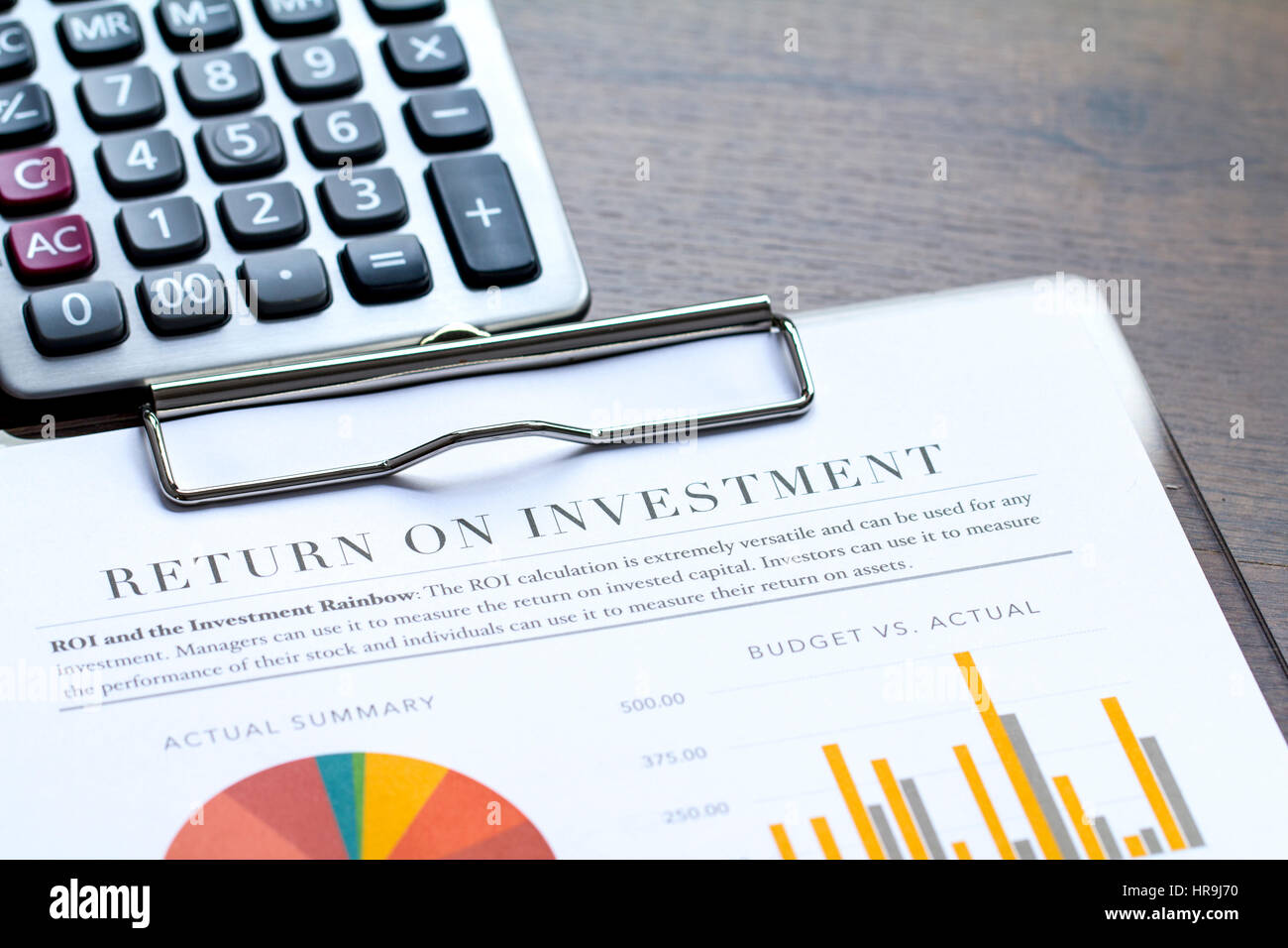 Return on investment analysis document zoom in with rainbow pie return on investment analysis document zoom in with rainbow pie chart graph and upperright copy space nvjuhfo Choice Image