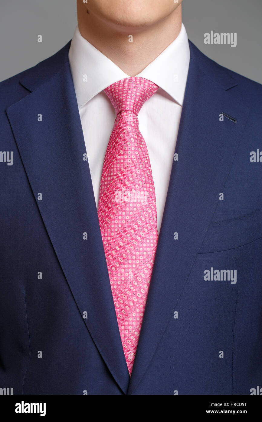 man in blue tuxedo with pink tie and white shirt Stock Photo ...