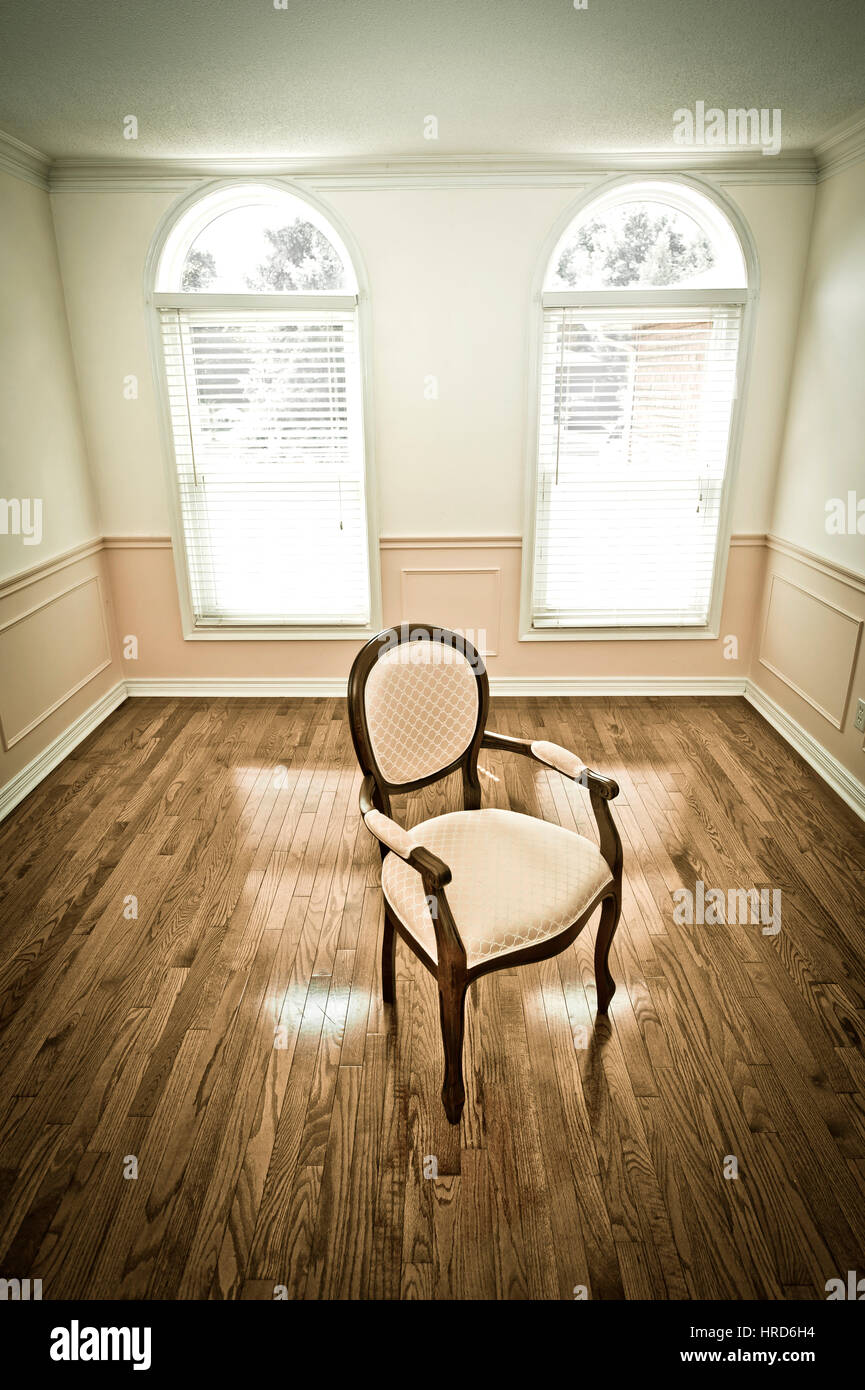 Empty chair in room - Stock Photo Empty Chair In An Empty Room