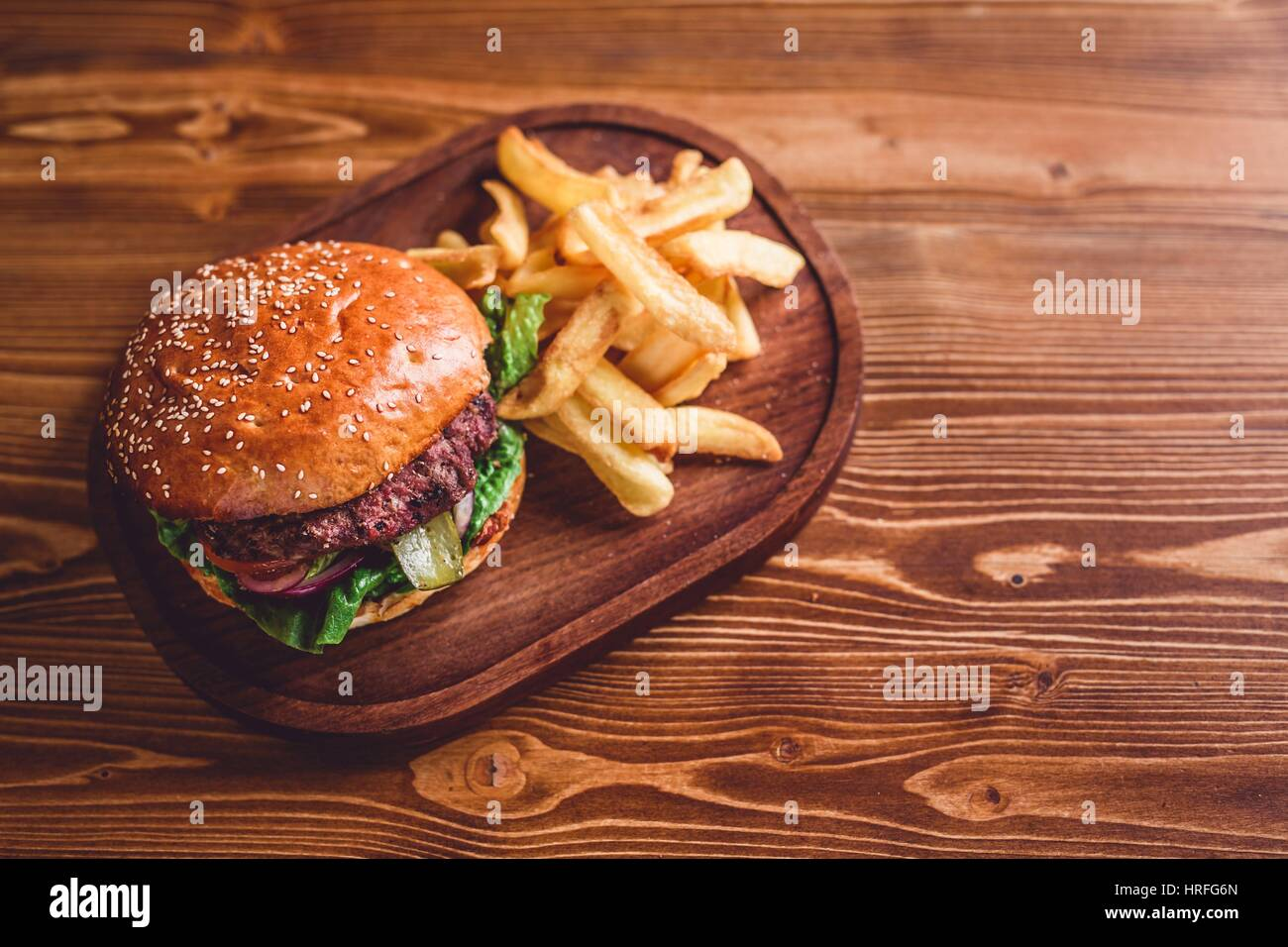 Top view on fresh burger on wooden table stock photo for Table burger