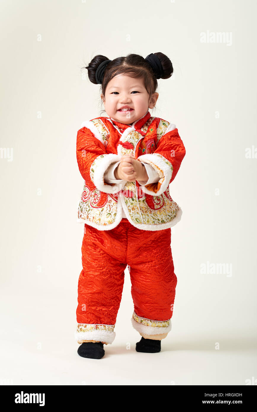 chinese baby girl in traditional chinese new year outfit celebrating lunar new year - Chinese New Year Outfit