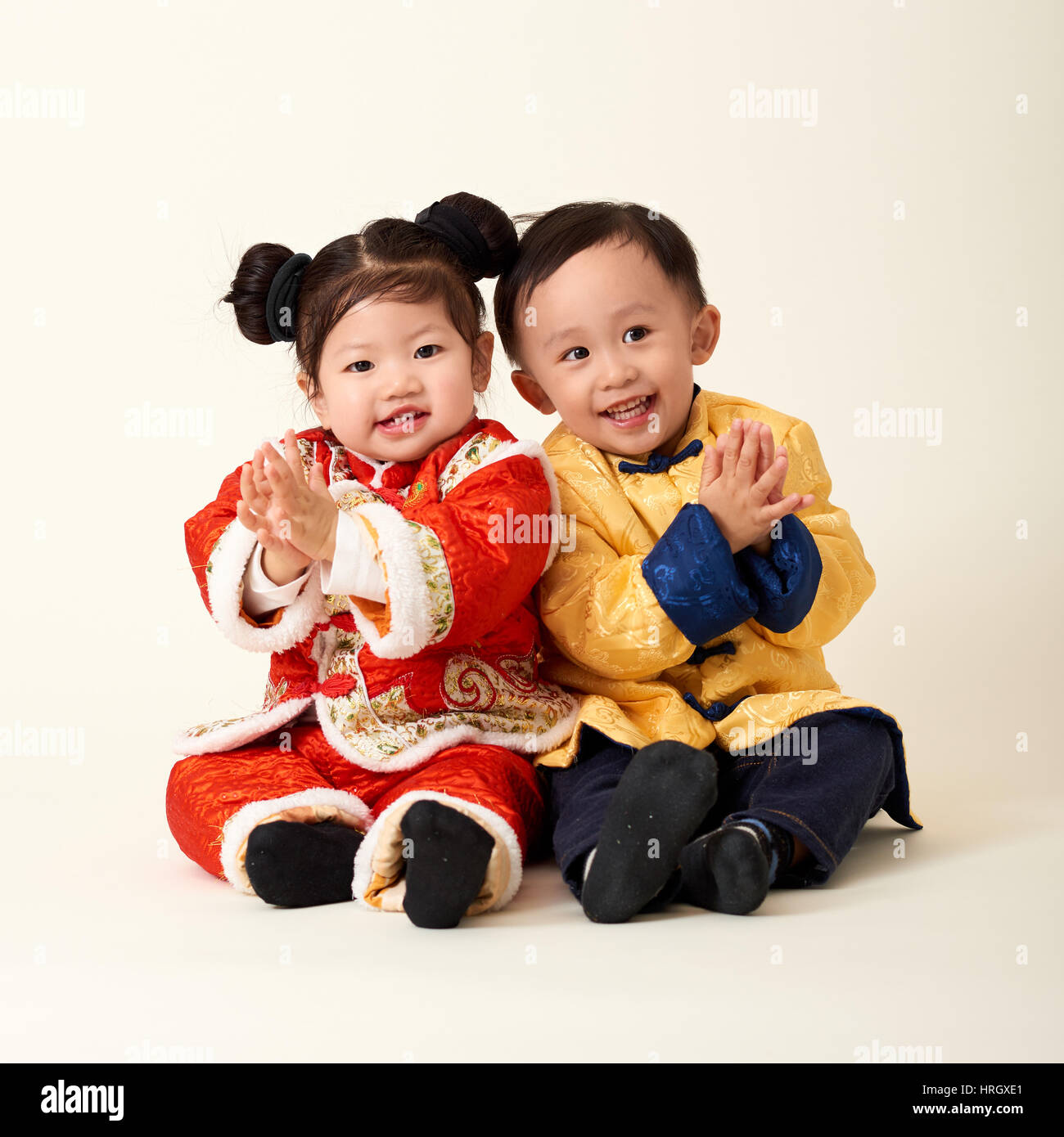 chinese baby boy and girl in traditional chinese new year outfit celebrating lunar new year - Chinese New Year Outfit