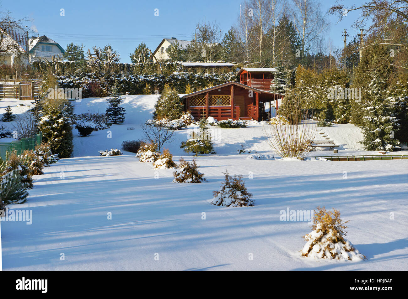 Stock Photo   Wooden Rural No Name Shed In Winter European Garden. Sunny  Day Landscape