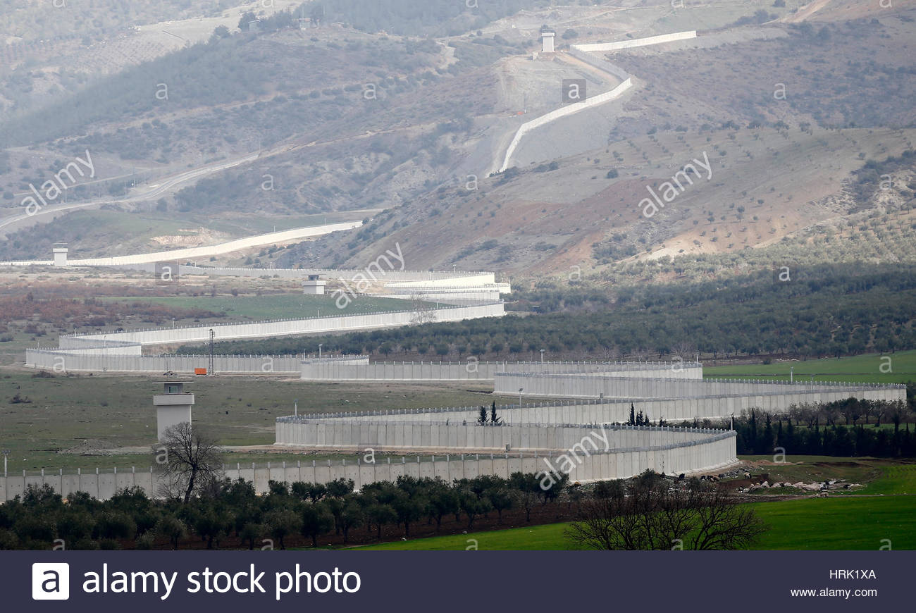 Turkish military involvement in Syrian war - Page 3 A-wall-along-the-border-between-turkey-and-syria-is-seen-near-the-HRK1XA
