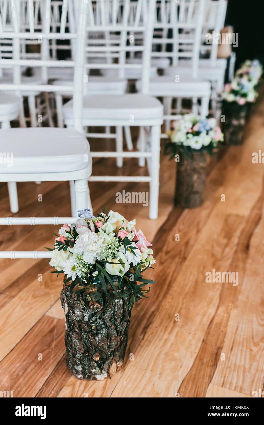 Wedding bouquet in timber vase on wooden floor in ceremony place wedding bouquet in timber vase on wooden floor in ceremony place reviewsmspy