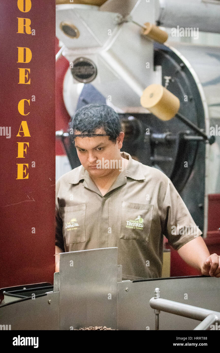 A worker is roasting coffee beans at a plant in San Marcos, Costa ...