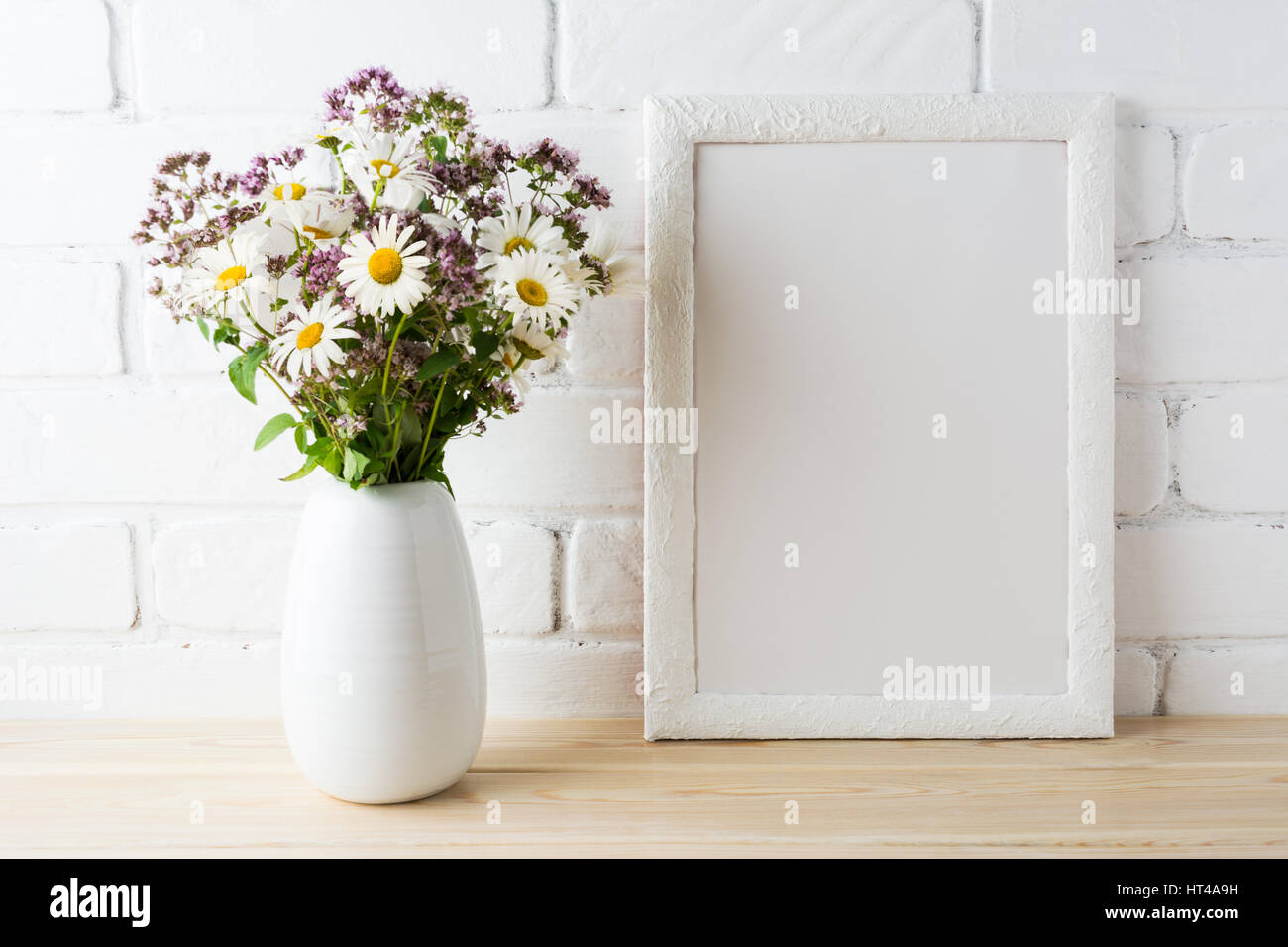 White frame mockup with blooming wildflower bouquet in in styled white frame mockup with blooming wildflower bouquet in in styled vase near painted brick wall empty frame mock up for presentation design template reviewsmspy