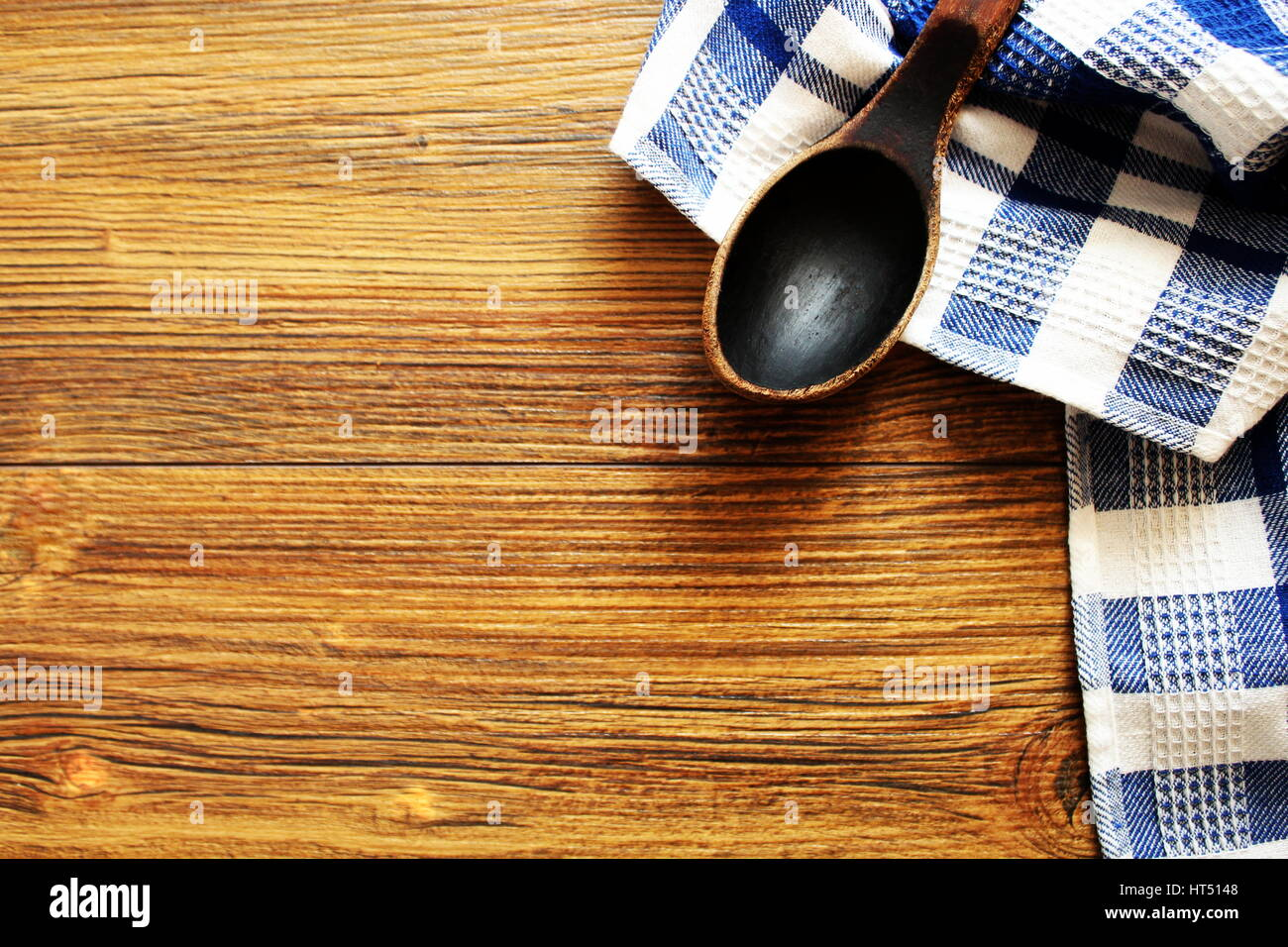 Wooden spoon on wood texture of dining table top view