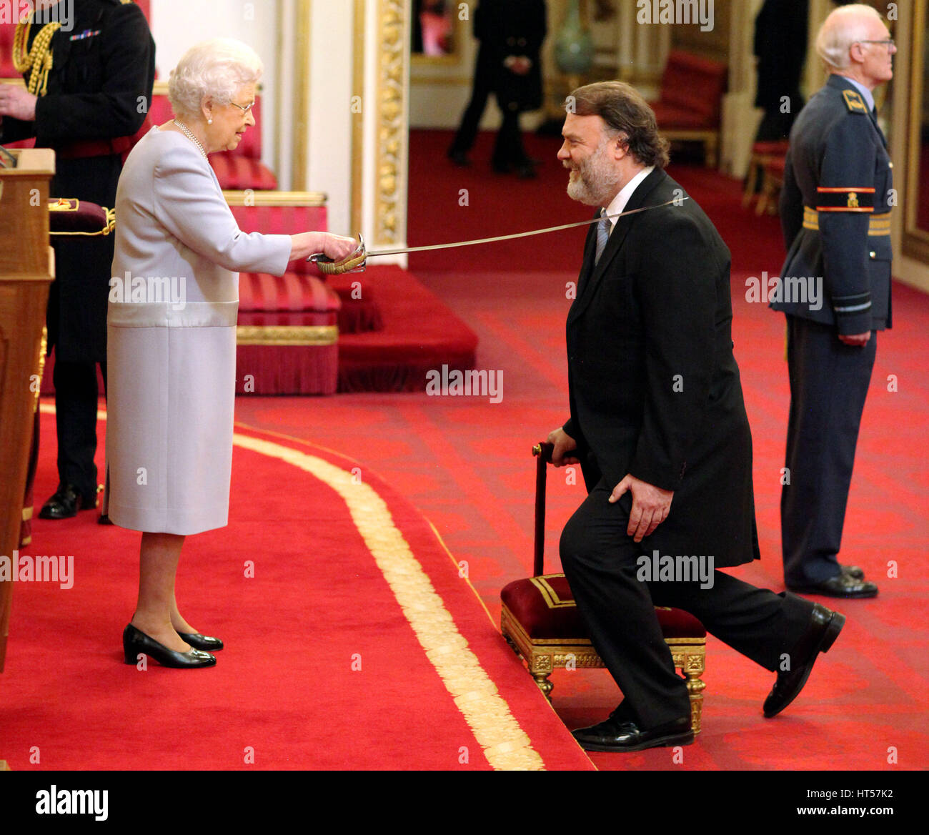 Sir Bryn Terfel Jones from London is made a Knight Bachelor of the British Empire by Queen Elizabeth II at Buckingham Palace.
