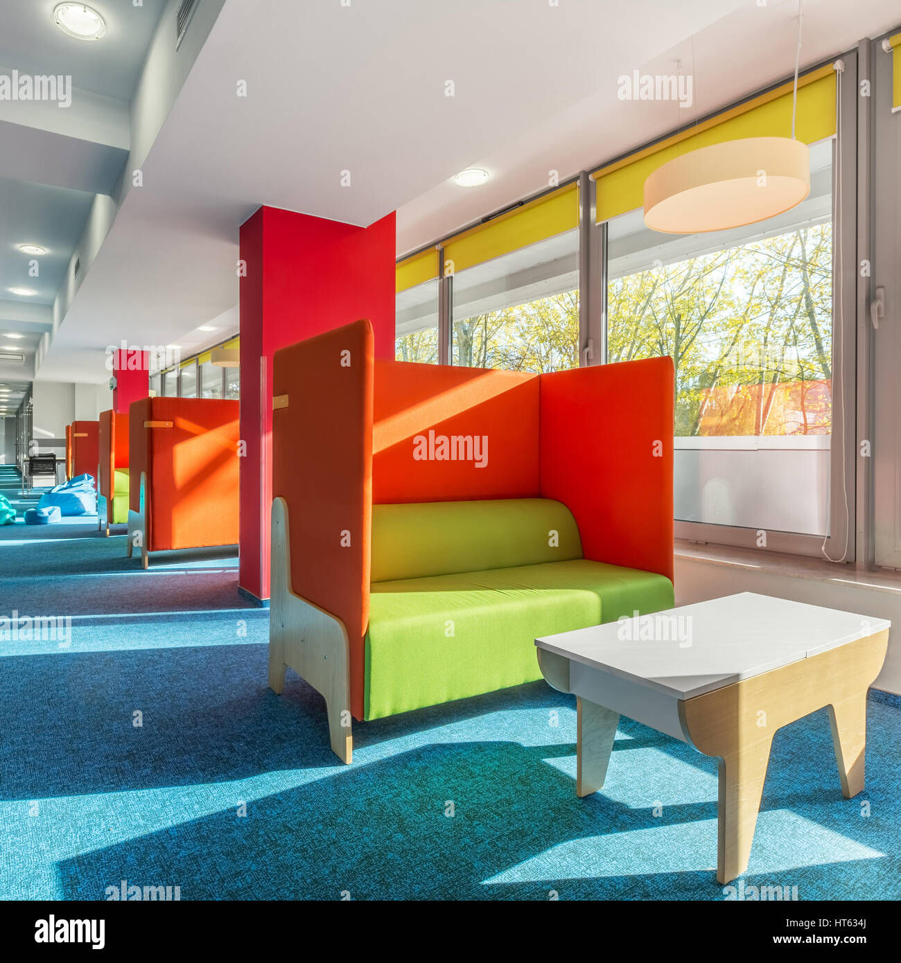Library Lounge Area With Green Sofas And Red Partitions
