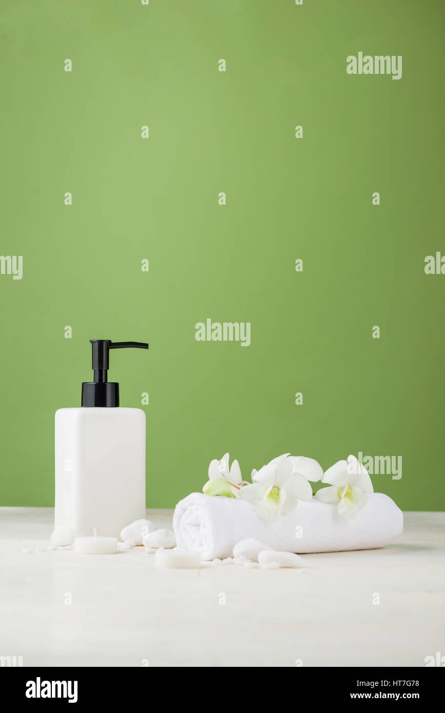SPA Decoration. Spa composition with cosmetic bottle over green ...