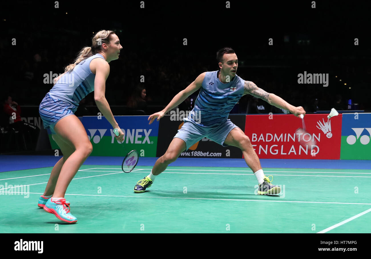 England s Chris Adcock right and Gabrielle Adcock in action