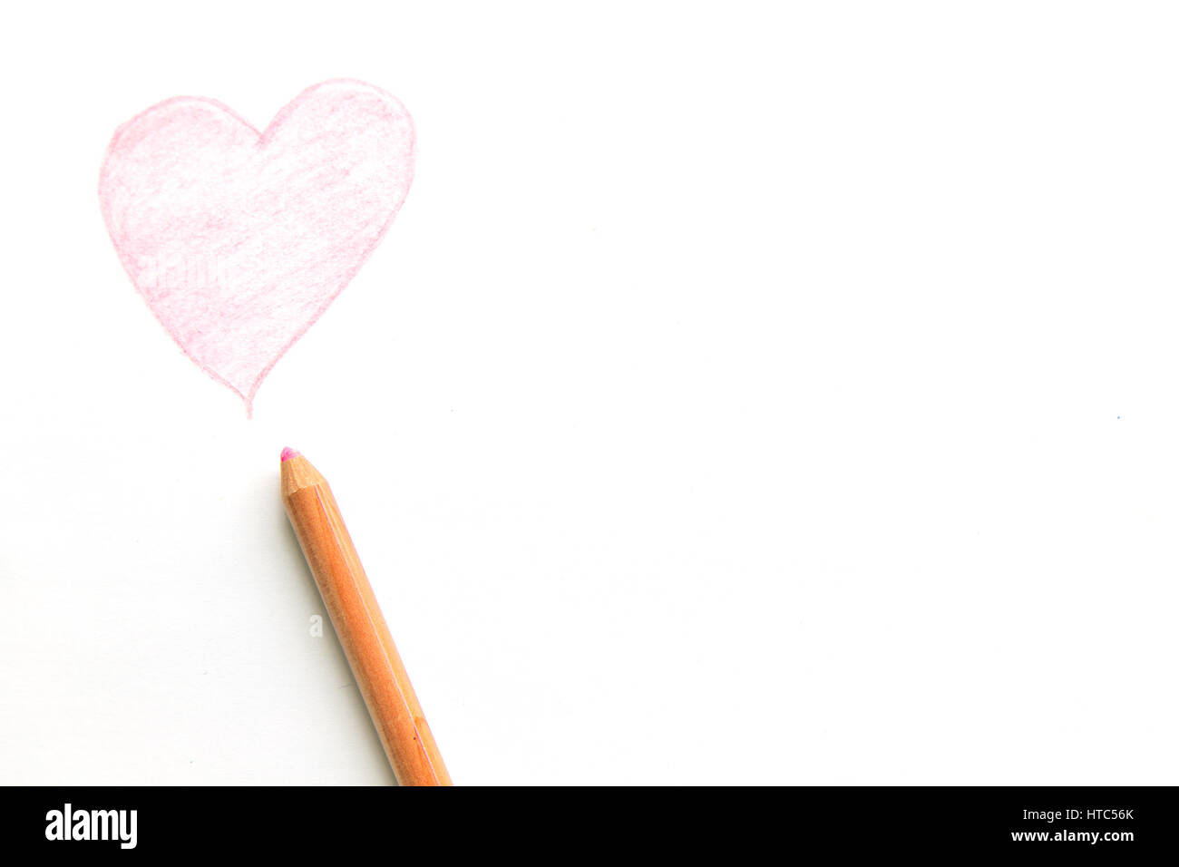 Line Drawing Heart Shape : Drawing heart shape with pencil isolated on white background stock