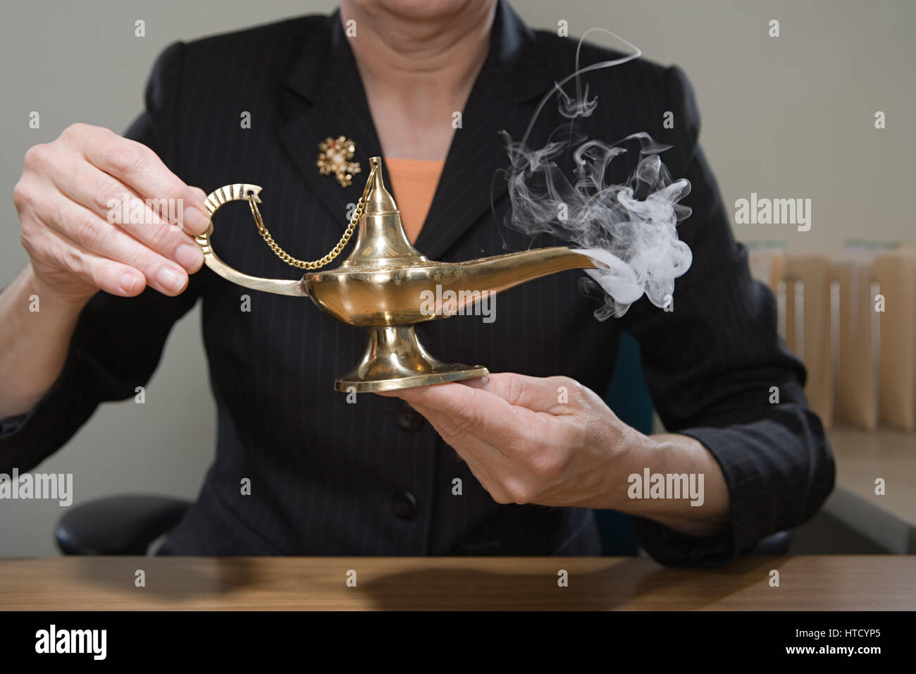 Genie lamp stock photos pictures royalty free genie - Stock Photo Woman Holding Genie Lamp