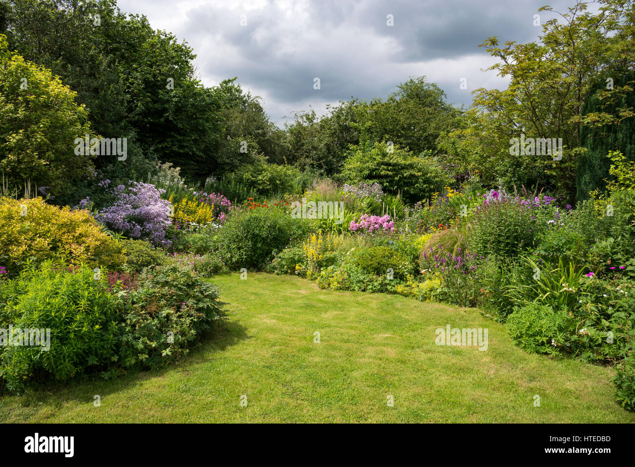 Colourful Flower Borders In A Cottage Garden Style Mixed