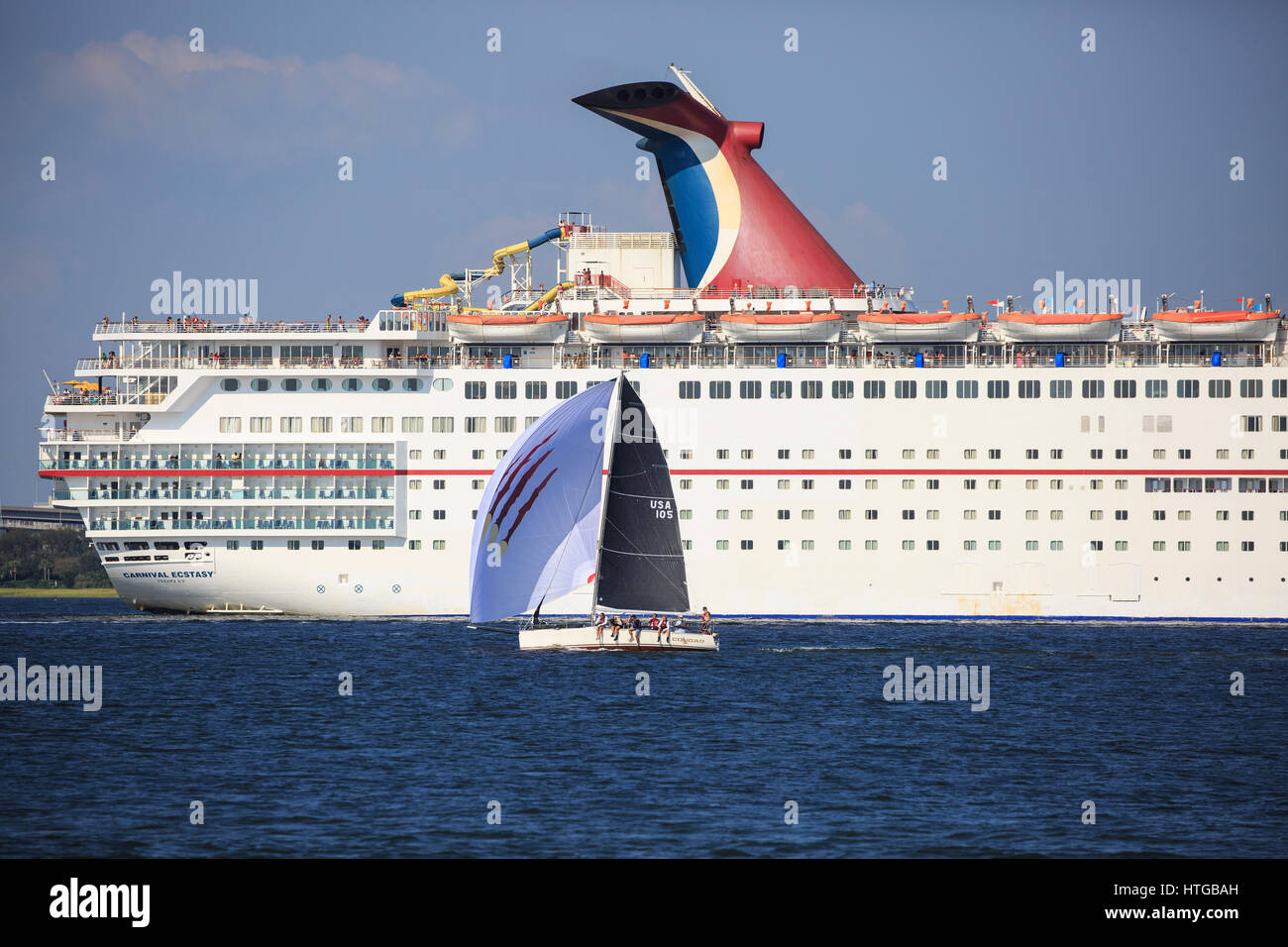 Small Sailboat In Front Of A Large Cruise Ship In Charleston - Cruise ships out of charleston south carolina