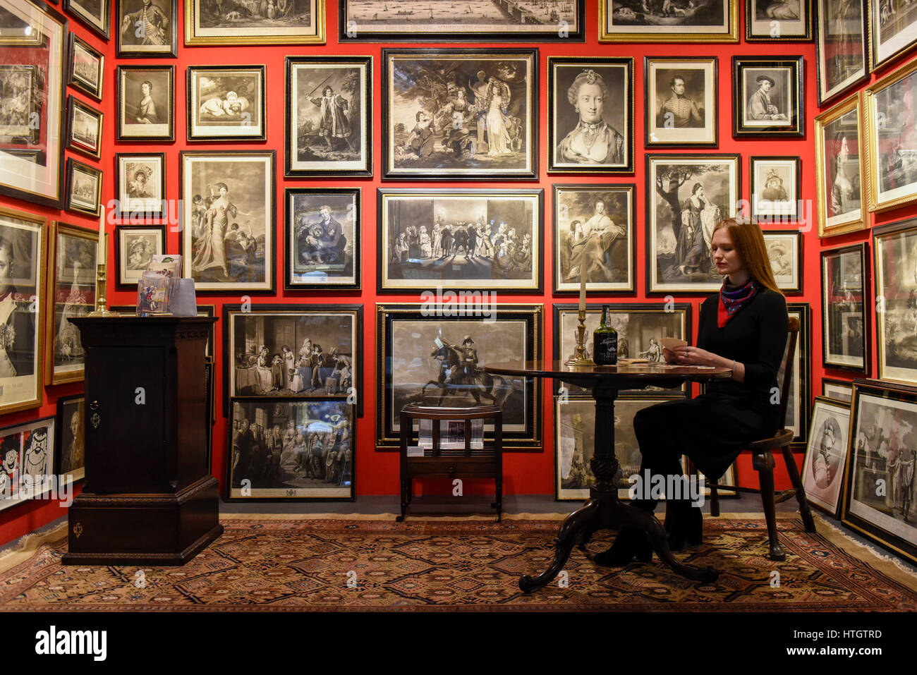 London UK 15 March 2017 A Staff Member Sits In Georgian Print Room At The British Antique Dealers Association BADA Fair Which Opened Duke Of
