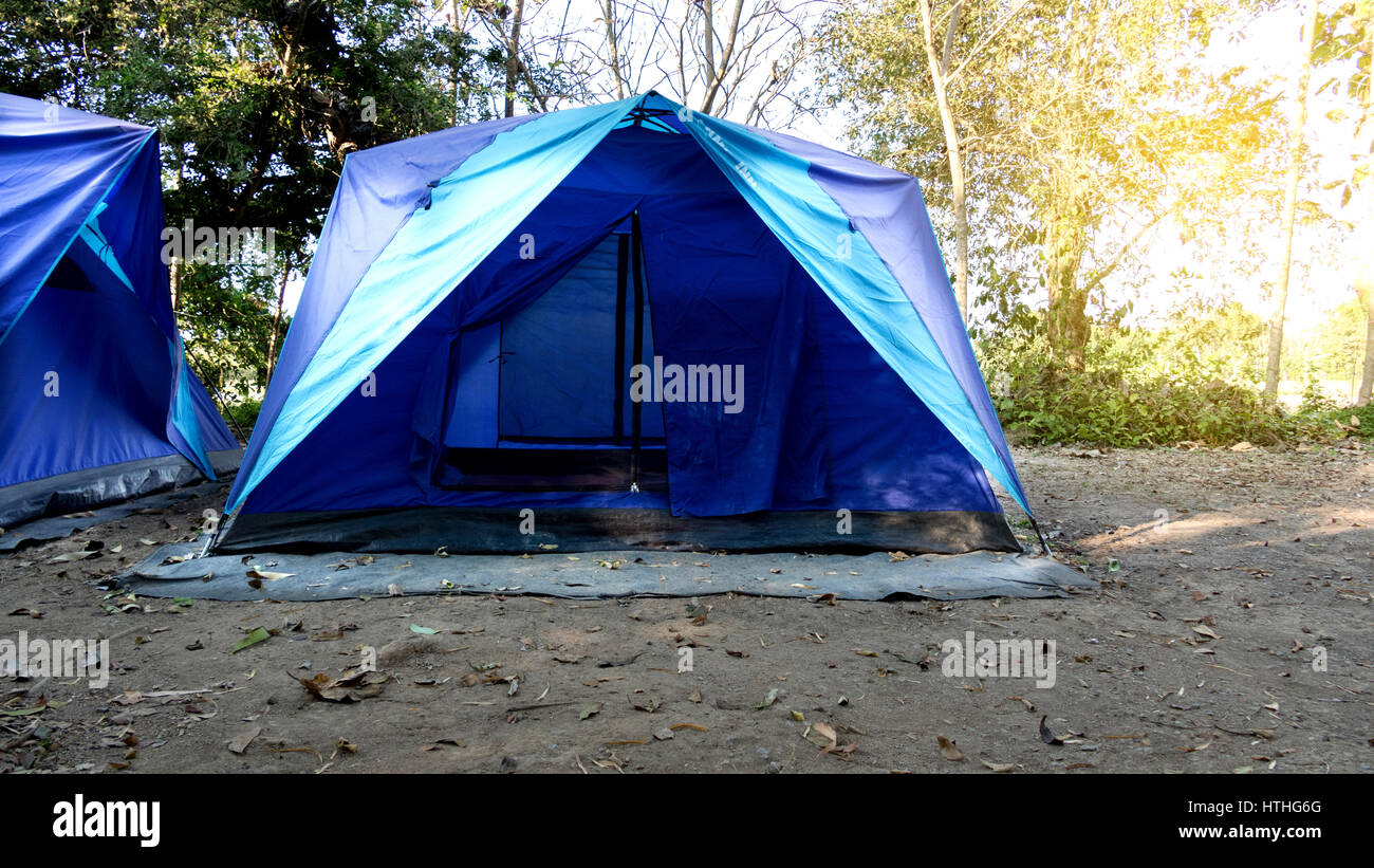 blue tent c&ing in forest outdoor travel concept & blue tent camping in forest outdoor travel concept Stock Photo ...