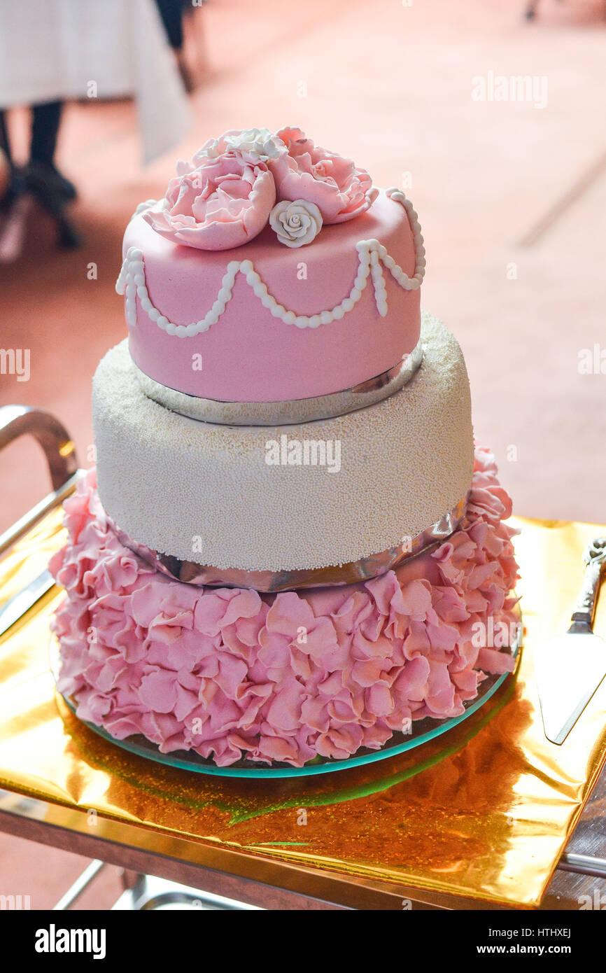 Round multi tiered wedding cake with sponge, cream, jam and fruit on ...