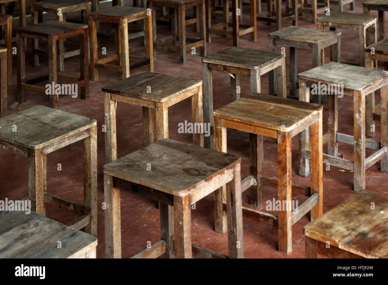 Old wooden chairs - Stock Photo Pile Of Old Wooden Chair In Empty Room