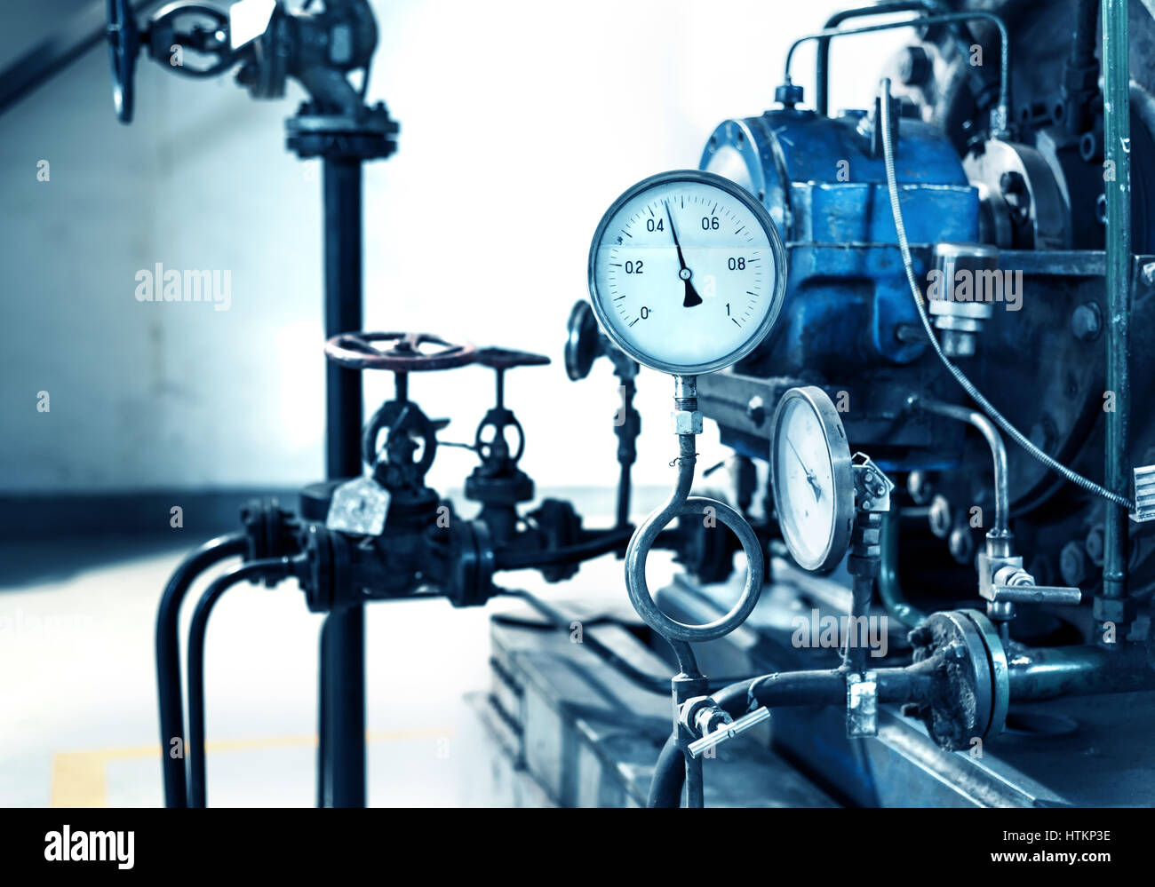 Closeup of manometer, pipes and faucet valves of heating system in a ...