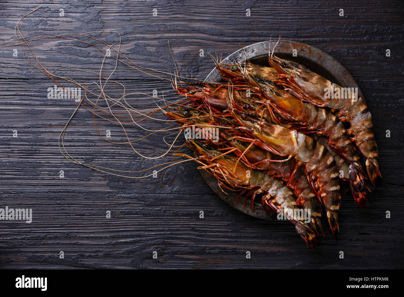 Raw fresh Tiger Prawn Shrimp in metal plate on burned ...