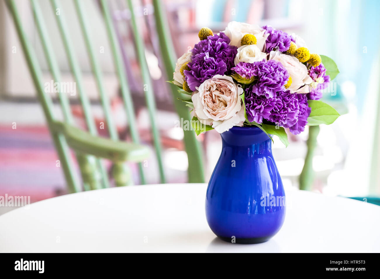 Wedding Bouquet Of Pink And Purple Flowers In Blue Vase Closeup