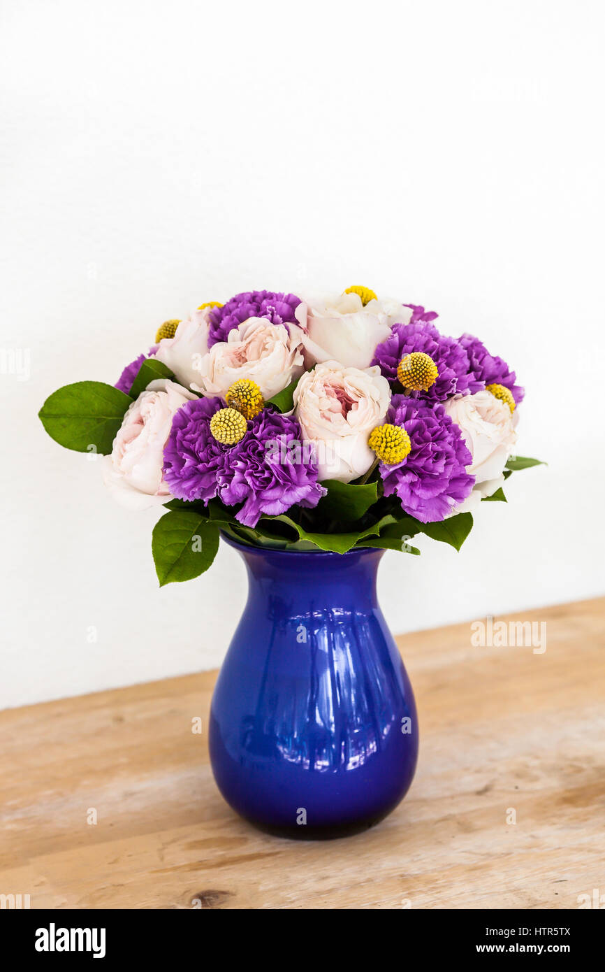 Wedding Decorating Bouquet Of Pink And Purple Flowers In Blue Vase